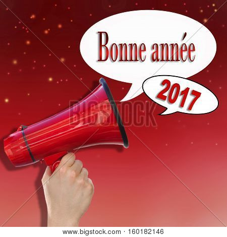 dictaphone on red background announcing in french a Happy new yer 2017 written in bubbles