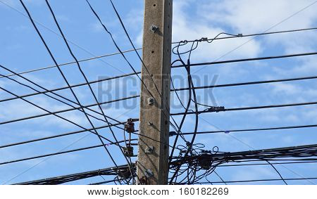 electric pole and complex cable wire on sky background