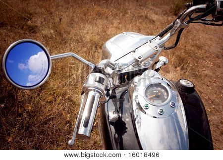 Reflection Of Blue Sky And Clouds In The Rearview Mirror Motorcycle