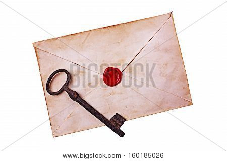 Old envelope with red wax and rusty key isolated on white background