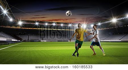 Soccer players fighting for ball . Mixed media