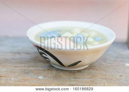Dumplings in coconut cream (Bua Loi) on Thai silk Dessert of Thailand.