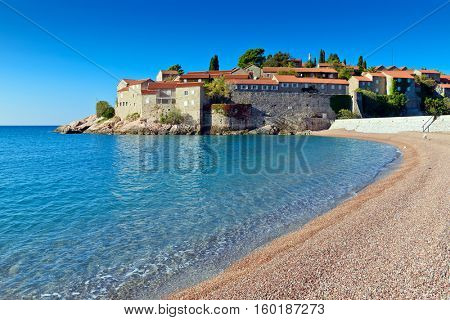 Sveti Stefan island  old  town castle,  view from beach. Montenegro, Europe
