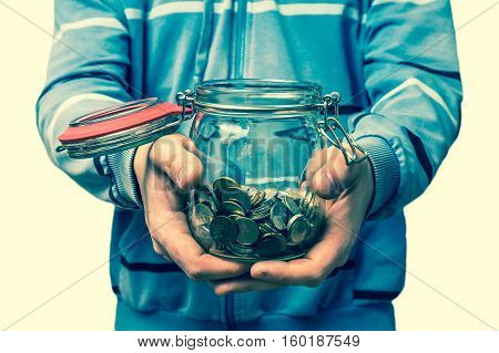 Man Holding Money Jar With Coins - Retro Style