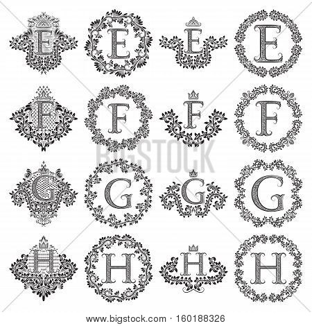 Vintage monograms set of letters E F G H. Heraldic coats of arms symbols in floral round frames.