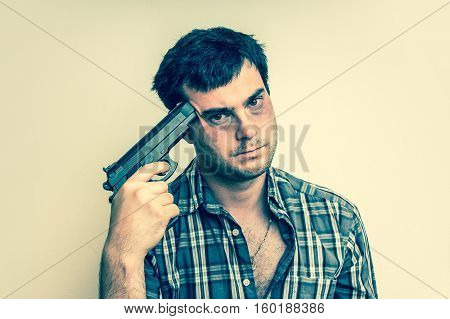 Depressive Man Trying To Commit Suicide With A Gun