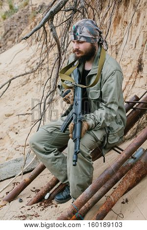 Armed man in a zone of armed conflict.