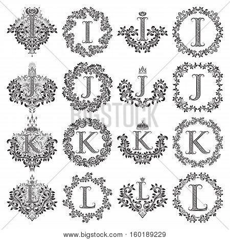 Vintage monograms set of letters I J K L. Heraldic coats of arms symbols in floral round frames.