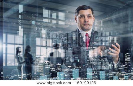 Senior businessman use tablet . Mixed media