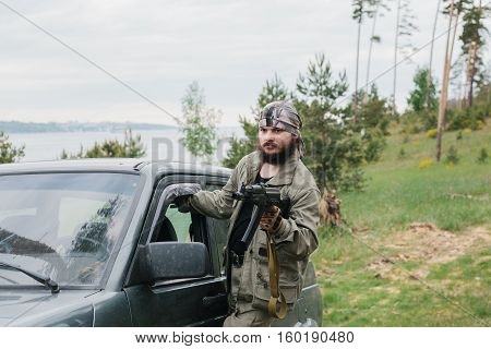 chase. Armed man in a zone of armed conflict