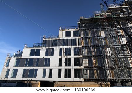 AARHUS DENMARK - NOVEMBER 24 2016: New modern apartment building site with windows and balconies all over. The new building at Aarhus Harbour is not yet finished November 24 2016