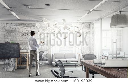 Handsome busy businessman making notes . Mixed media