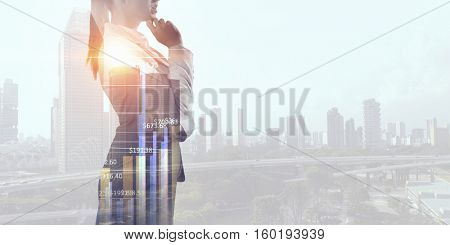 Exposure of businesswoman and modern city . Mixed media