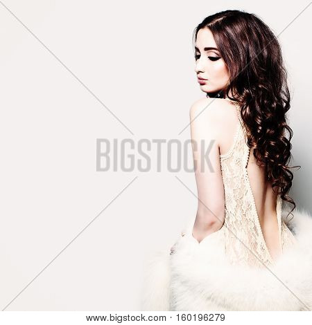 Glamorous Woman Fashion Model with Long Brown Hair Posing