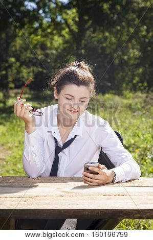 Young Beautiful Business Woman Reads The Message On Your Cell Phone