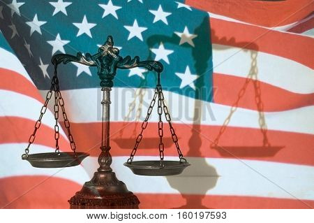 Symbol of law and justice with shadow United States flag background law  justice concept