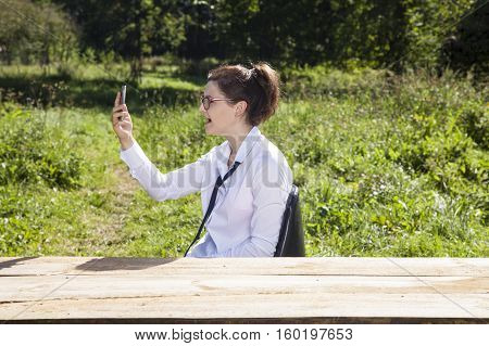 Surprised Business Woman Checks Her Mobile Phone