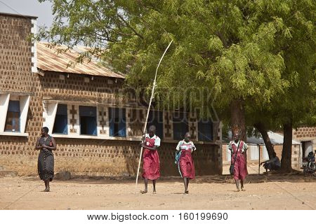 TORIT, SOUTH SUDAN-FEBRUARY 20 2013: Unidentified female students leave the primary school in Torit, South Sudan