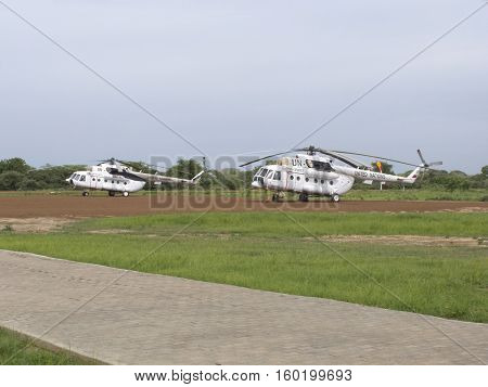 BOR, SOUTH SUDAN-JUNE 26, 2012: UN peacekeeping helicopters sit on the runway in Bor, South Sudan
