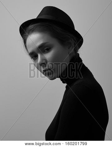 Dramatic Black And White Portrait Of Young Beautiful Girl With Freckles In A Black Turtleneck And A