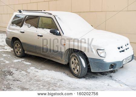 Smolensk, Russia - November 13, 2016: Subaru Forester parked in winter after snowfall.