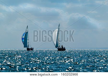 Ship yachts with white sails in the open sea. Sailing. Yachting.