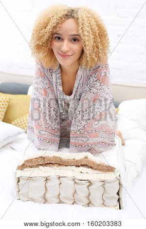 Spring mattress, comfortable and healthy sleep. Cross-section through the layers of the mattress.