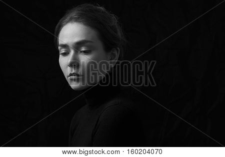 Dramatic Black And White Portrait Of Young Beautiful Girl With Freckles In A Black Turtleneck On Bla
