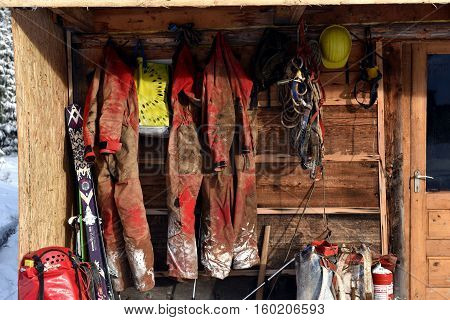 Cave Exploration Equipment Hanged On A Wooden Cabin