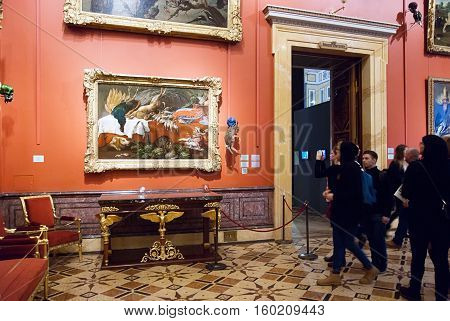 St Petersburg, Russia, Dec 1, 2016: People look at the stuffed rabbit with scull near painting in Hermitage  Exhibit of temporary modern art exhibition
