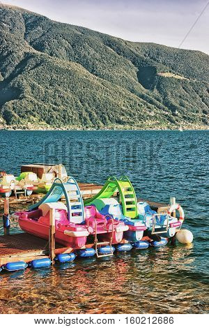 Ascona, Switzerland - August 25, 2016: Catamarans at the promenade of the luxurious resort Ascona on Lake Maggiore in Ticino canton in Switzerland.