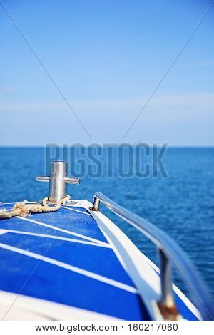 View from a blue boat on the ocean. Boat is sailing around the islands in Thailand. Exotic summer holiday trip voyage.