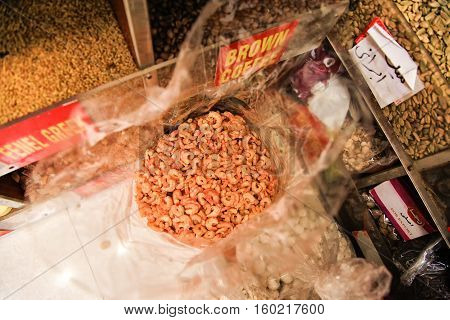 Detail of small dried salted prawns in a clear bag. Photo is taken in Spice Souk Dubai
