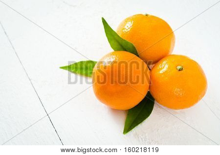 Fresh Organic Tangerines on a White Wooden Background. Delicious and Beautiful Tangerines. Selective Focus.