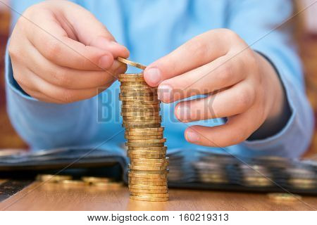 Child Amassed A Large Pile Of Gold Coins, Close-up