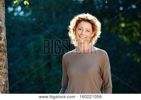 Happy Older Hiker Standing In Tranquil Park