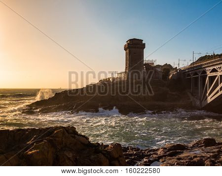 Torre di Calafuria Seashore and Choppy Sea at Sunset in Livorno Italy