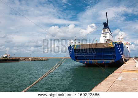 Boat's Stern and Rope Tied to Bollard in Port