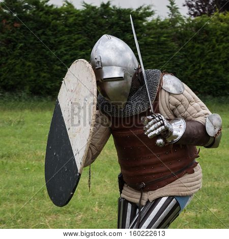 Knight In Battle With Silver Helmet, Armor, Shield And Sword