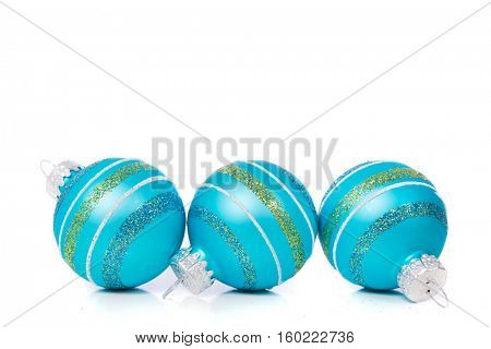 Blue Christmas ornaments on a white background with copy space