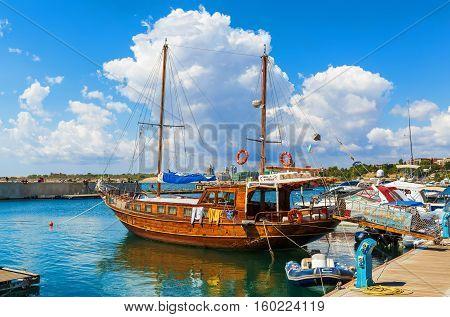 NESEBAR BULGARIA SEPTEMBER 06 2013: Pleasure yacht in the port of Nesebar old town. Wooden passenger sailing ship standing at the pier on the coast of the Black Sea.