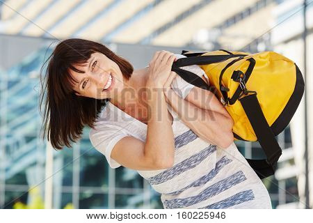 Happy Traveler Carrying Duffel Bag Over Shoulder