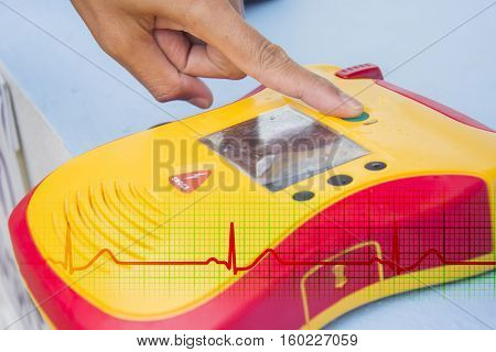 Automated External Defibrillator show finger push button open
