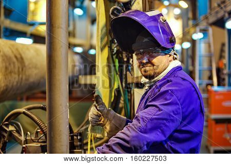 Safety at work. Welding and installation of the pipeline. Industrial weekdays welders and fitters.