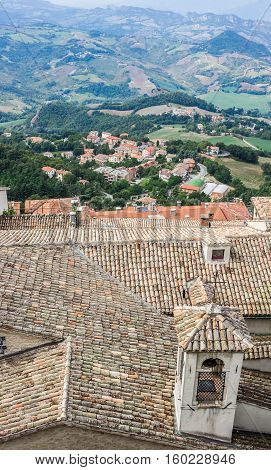City of San Marino. Aerial view from the hill with rooftops on the foreground. The Republic of San Marino