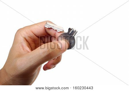 Hand holding a usable key and a broken key / Symbol of success and failure concept