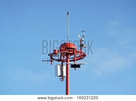 Weather measurement unit with blue sky background / Low Level Wind Shear Alert System : LLWAS