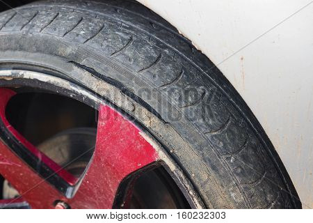 Old tire of a car with break / Danger of using an old tire for driving concept