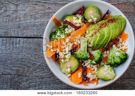 Couscous with broccoli avocados carrots Brussels sprouts dried tomatoes and pine nuts. . Perfect for the detox diet or just a healthy meal. Love for a healthy raw food concept.