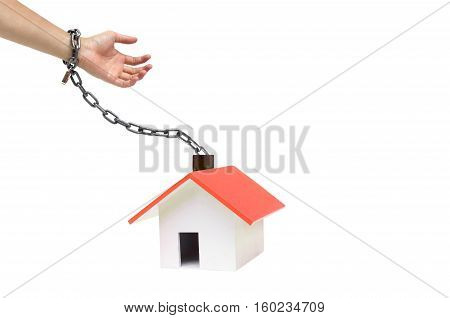 Hand chained with a house / Buying a house causing debts concept